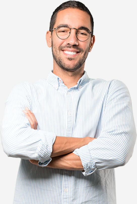A man with glasses wearing a blue and white stripe button down shirt with his arms crossed in front of him