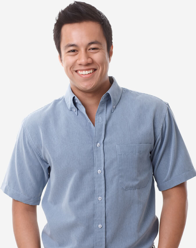 A male business owner wearing a short sleeve button down shirt